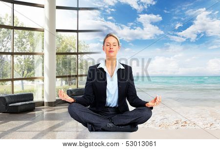 Meditation. Relaxing business woman on the beach