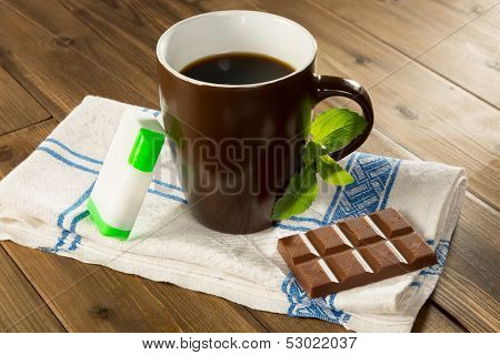 Belgian chocolate made with stevia instead of sugar and a cup of coffee with stevia tabs