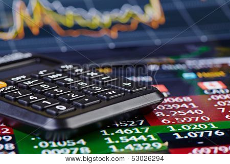 Calculator And Financial Chart As Background. Selective Focus