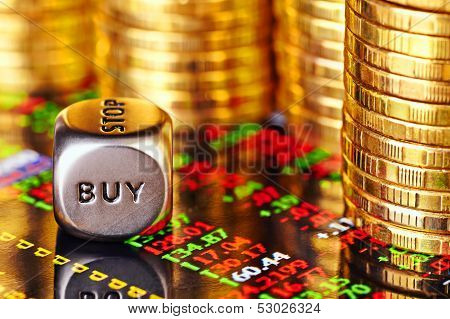 Financial Chart, Golden Coins And Dices Cube With The Word Buy. Selective Focus