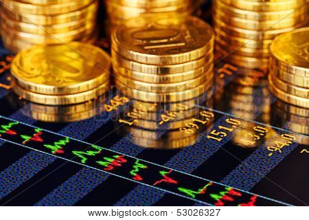 Golden Coins And Financial Chart. Selective Focus