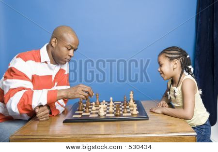 Man Playing Chess With His Daughter