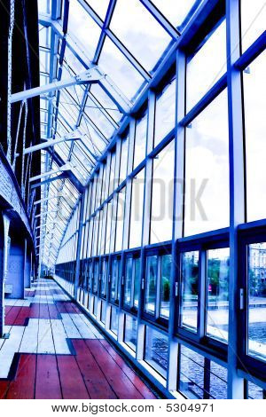 Glass corridor in office center with bright colours poster