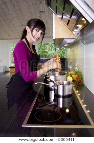 Woman Stirring In A Saucepan