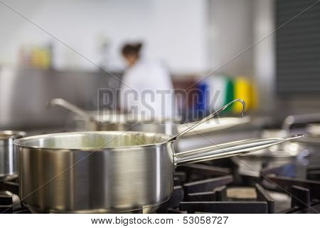 Chrome pot cooking on hotplates in professional kitchen