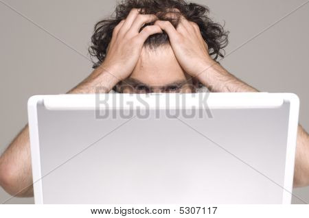 Man Looking At Computer In Desperation
