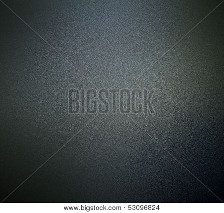 Abstract texture of dark grey and light black smooth brushed metal background