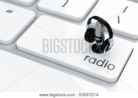3d render of microphone with headphones icon on the keyboard. Radio concept poster