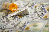 Medicine Pills Stacked Like Increasing Graph on Newly Designed U.S. One Hundred Dollar Bills. poster
