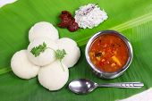 idli, sambar, coconut and lime chutney, south indian breakfast on banana leaf poster