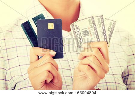 Woman with a credit card and cash on her hand