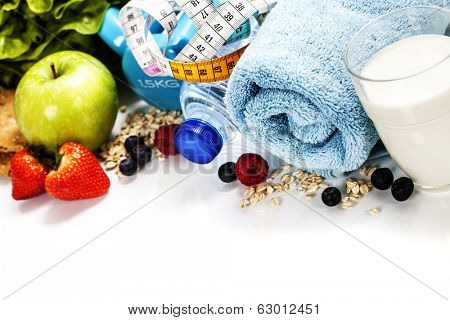 Different tools for sport and healthy food for diet on white background - sport, health and diet concept poster