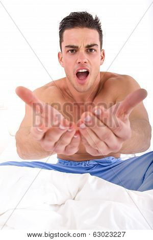 Half Naked Handsome Man In Bed With Hands Out Towards Camera