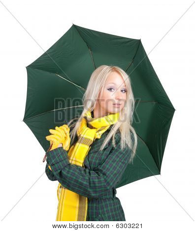 Blonde girl in green coat with umbrella over white poster