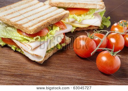 Sandwiches On Wooden Table