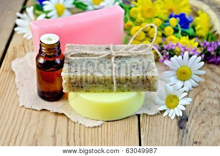 Soap With Oil And Wildflowers On Board