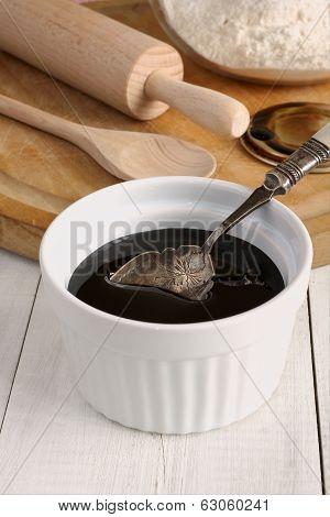 Black Treacle or Blackstrap molasses a dark sugar syrup used in baking