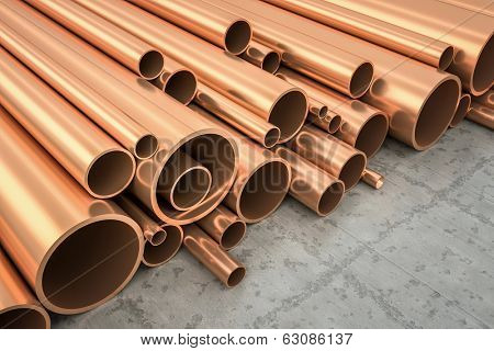 An image of some nice copper pipes in a warehouse