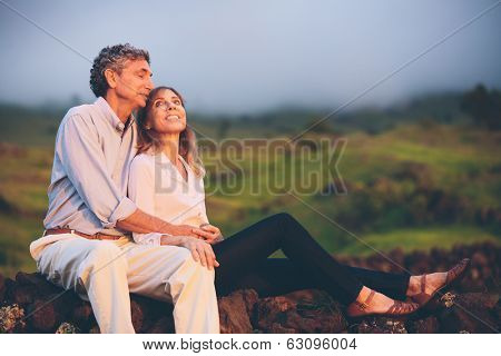 Happy loving middle aged couple, Romantic Moment Watching the Sunset in the Countryside