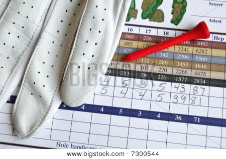 Golf Score Card With Glove And Red Tee