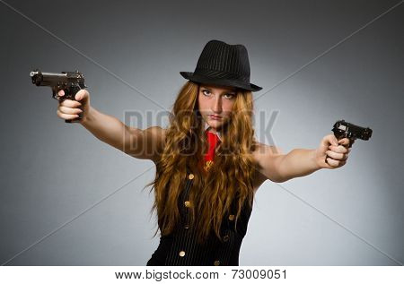 Woman gangster with gun in hand
