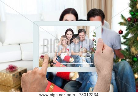 Composite image of hand holding tablet pc showing photograph