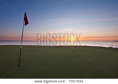 Sunrise Over The Sea From A Golf Green