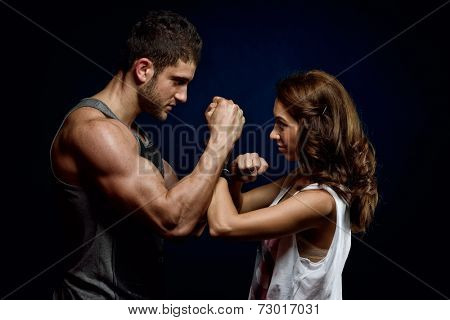 young athletic  couple  in the gym