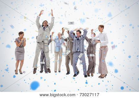 Very happy people with money falling from the sky against snow falling