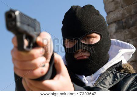 Criminal In Mask Aiming His Target