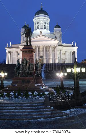 HELSINKI, FINLAND - JANUARY 12, 2012: Monument to Russian Emperor Alexander II against Helsinki Cathedral. The statue, erected in 1894, commemorated his re-establishment the Diet of Finland in 1863