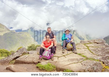 MACHU PICCHU, PERU - MAY 3, 2014 - group of tourists after climbing Huayna Picchu mountain