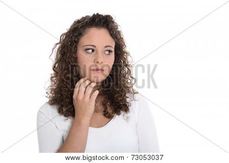 Isolated sad and thoughtful young woman looking sideways.