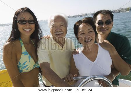Asian Family on sailboat in casual clothes