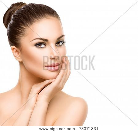 Beautiful Young Woman with Clean Fresh Skin close up isolated on white. Beauty Girl Portrait. Spa Woman Smiling and touching her skin. Perfect Fresh Skin. Face Model. Youth and Skin Care Concept