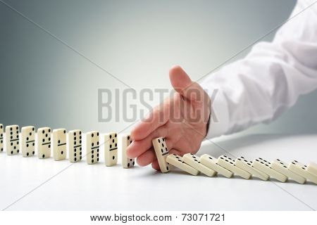 Stopping the domino effect concept for business solution, strategy and successful intervention poster