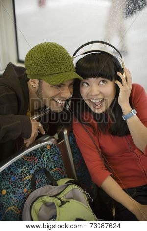 Couple listening to headphones