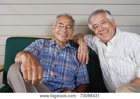 Portrait of two elderly men sitting and smiling
