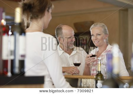 Man and woman wine-tasting selective focus