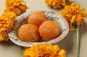 Boondi Ladoo - A traditional indian sweet in a earthen bowl poster
