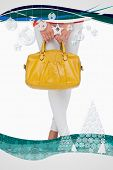 Composite image of Woman in high heels holding yellow bag with christmas frame poster