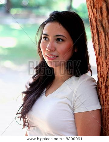 Pretty Woman by a Tree