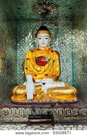 Buddha statue in Burma famous sacred place and tourist attraction landmark - Shwedagon Paya pagoda. Yangon, Myanmar poster