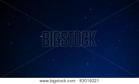 Night sky with stars and jet line