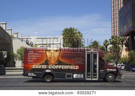 Airline shuttle bus with David Copperfield advertisement on Las Vegas Strip