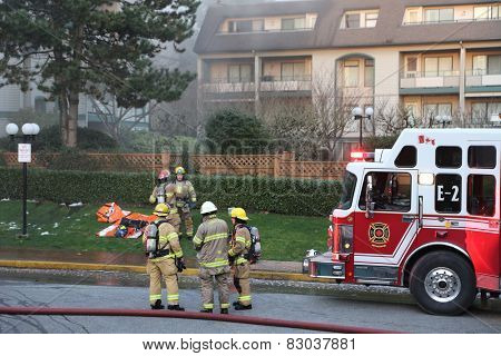 Coquitlam, BC, Canada - February 16, 2015 : Firefighter crews battling apartment complex fire on Glen drive in Coquitlam.