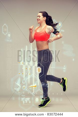 fitness, sport and dieting concept - beautiful sporty woman running or jumping