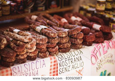 Salami And Sausages Sold In The Stall At An Outdoor Market Italy