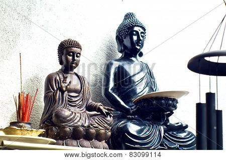 Two Buddhas On Shelf With Incense