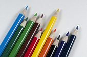 Concept picture of bright art pencils angled and sharpened poster